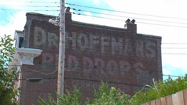 "St. Louis residents are debating what do with ""ghost signs"" old ads on buildings that pre-date the Great Depression. Credit: KMOV"