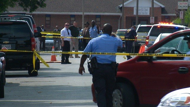 Officers on scene of a fatal shooting on Cote Brilliante in St. Louis. (KMOV)