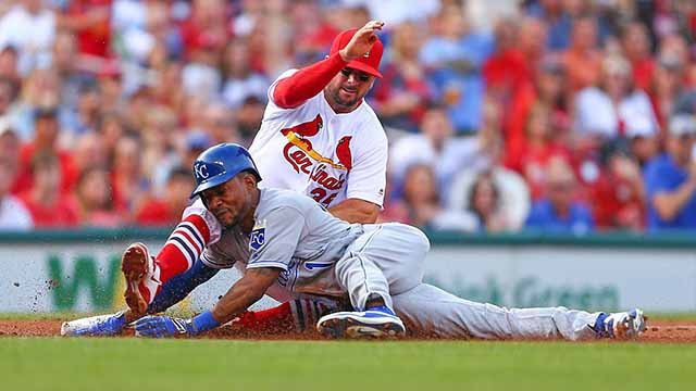 LOUIS, MO - JUNE 30: Jarrod Dyson #1 of the Kansas City Royals is caught stealing third base by Greg Garcia #35 of the St. Louis Cardinals in the second inning at Busch Stadium on June 30, 2016 in St. Louis (Photo by Dilip Vishwanat/Getty Images