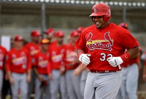 St. Louis Cardinals' Brayan Pena smiles as he arrives home after hitting a home run during a spring training intrasquad baseball game Monday, Feb. 29, 2016, in Jupiter, Fla. (AP Photo/Jeff Roberson)