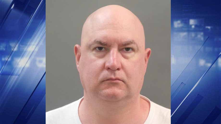 David Allen White, 46, of Collinsville, is accused of using his security access to break into a woman's hotel room at the Hyatt Downtown and grope her while she was asleep. Credit: SLMPD