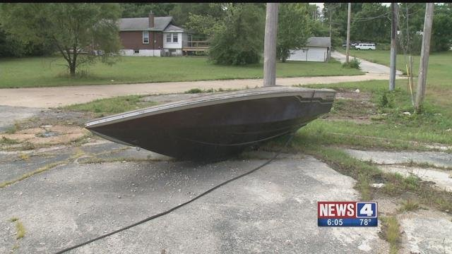 Residents of a South City neighborhood are upset after someone dumped an old boat. Credit: KMOV
