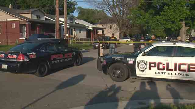 East St. Louis police on scene after a man was shot multiple times during a rolling gun battle on July 7 (Credit: KMOV).