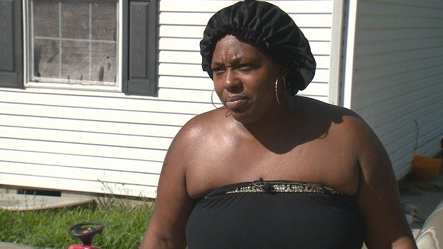 A Cahokia mother says she was arrested for failing to cut her grass (Credit: KMOV).