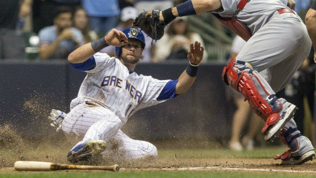 Milwaukee Brewers' Kirk Nieuwenhuis, left, slides in safely past the tag of St. Louis Cardinals' Yadier Molina on teammate Jonathan Villar's walkoff single to left during the ninth inning (AP Images)