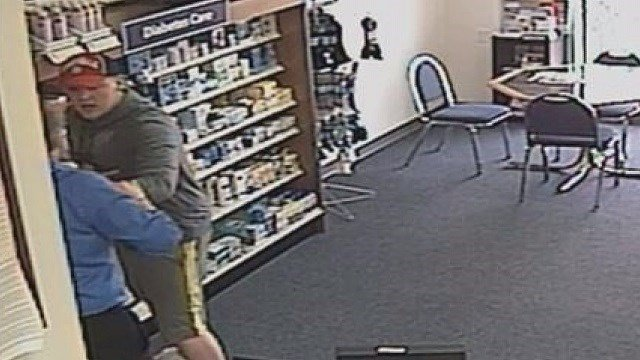 Zachary Mesey terrorizing the store owner at Medicine Shoppe Pharmacy in St. Clair, Mo. in April 2015 (Credit: Medicine Shoppe Pharmacy)