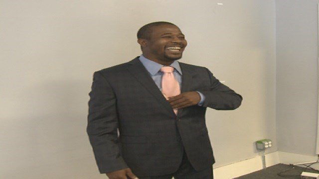 Trevor Hughes trying on his tailored suit from Saint Louis Suit Project (Credit: KMOV)