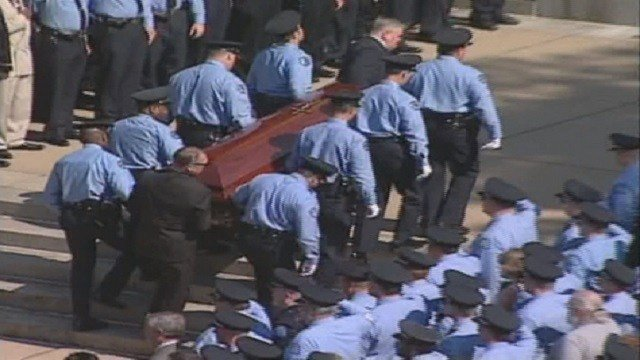 Officer Robert Stanze's funeral in 2000 after he was gunned down (Credit: KMOV).