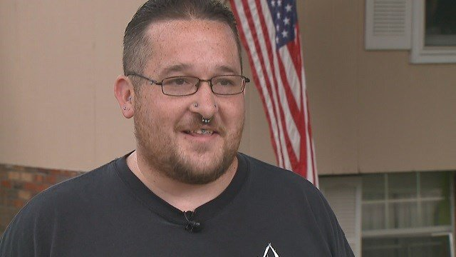 Dustin Blevins, Pokémon player, helps woman in distress at Poké Stop (Credit: KMOV).