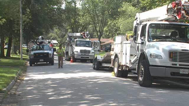 Crews in Monroe County, Illinois work to restore power on July 19. Credit: KMOV