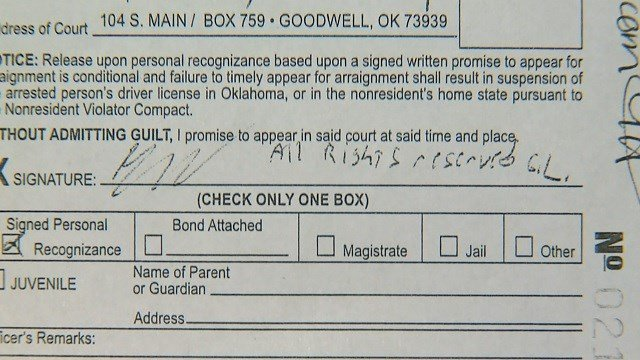 A citation shows Gavin Long wrote All Rights Reserved next to his initials (KMOV, Goodwell Police Department)