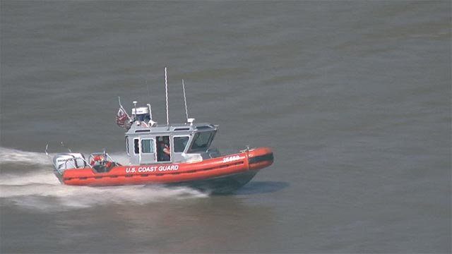 A U.S. Coast Guard boat searching for a Mississippi kayaker in the Mississippi River (Credit: KMOV)