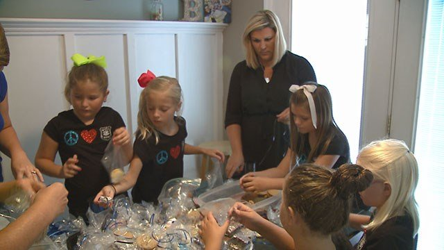 Local Girl Scout troop organize bake sale to raise money for Officer Flamion on July 22 in Ballwin, Mo. (Credit: KMOV).