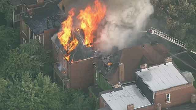 A fire in the 3800 block of Greer engulfed a vacant home and spread to two other homes. Credit: KMOV