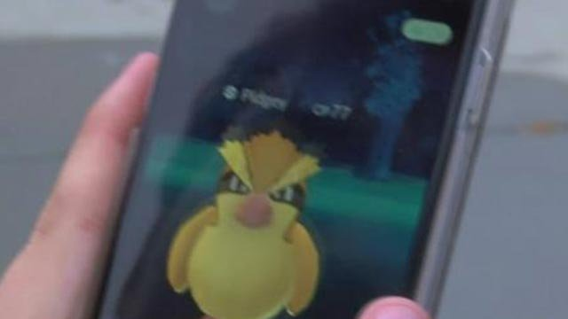 Person playing Pokemon Go (Credit: KMOV)