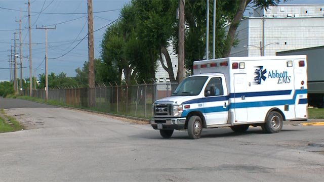 An ambulance leaving the Custom Steel Processing plant in Venice on Friday (Credit: KMOV)