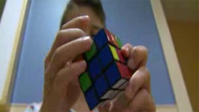Dylan Hirth completing a Rubik's Cube (Credit: KMOV)