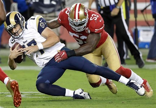Los Angeles Rams quarterback Case Keenum (17) is tackled by San Francisco 49ers linebacker NaVorro Bowman (53) during the second half of an NFL football game in Santa Clara, Calif., Monday, Sept. 12, 2016. The 49ers won 28-0. (AP Photo/Marcio Jose Sanchez