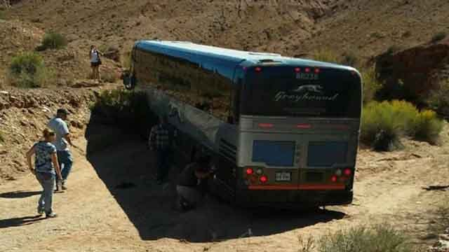 Passengers on a Greyhound going from St. Louis to Las Vegas were asked to get out and push when the bus became stuck in the mud near a town in Utah. Credit: Passenger named Quentin