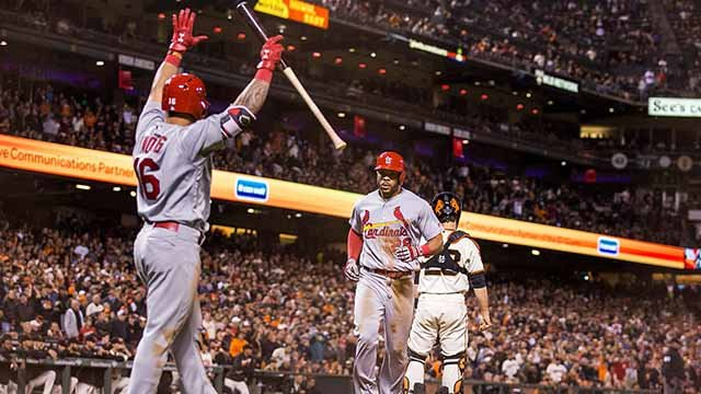 Kolten Wong #16 (L) of the St. Louis Cardinals celebrates as Tommy Pham #28 brings in a run to tie the game against the San Francisco Giants in the ninth inning at AT&T Park on September 17, 2016 in San Francisco, California. (Photo by Andrew Burton/Getty