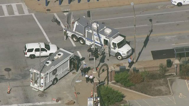An aerial view of police and bomb squad vehicles convene on the intersection of 14th Street and Clark Avenue (KMOV)