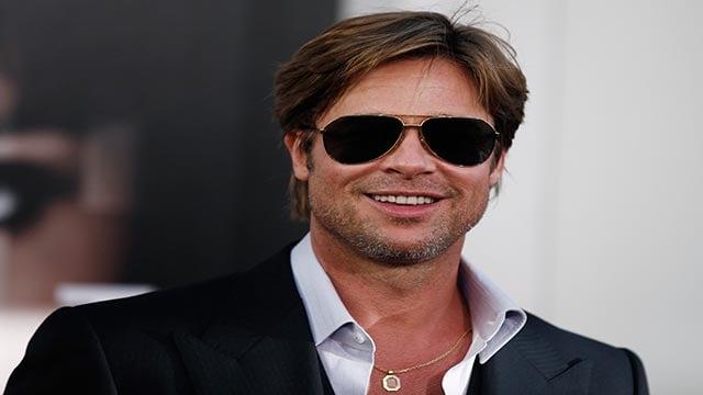 "Actor Brad Pitt arrives at the premiere of ""Salt"" in Los Angeles, on Monday, July 19, 2010. (AP Photo/Matt Sayles)"