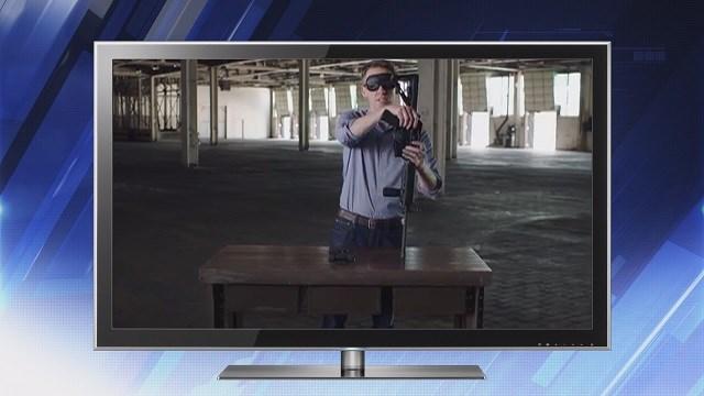 Jason Kander (D), Secretary of State of Missouri assembles gun blindfolded during ad (Credit: KMOV).