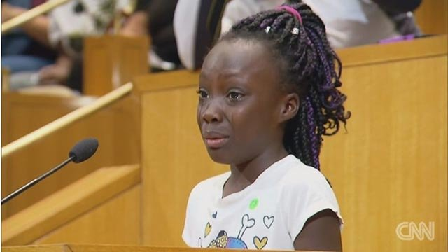 Zianna Oliphant climbed up a step ladder to stand at the podium before a tense Charlotte City Council meeting and amade a tearful plea saying black parents are getting killed. (Credit: CNN)