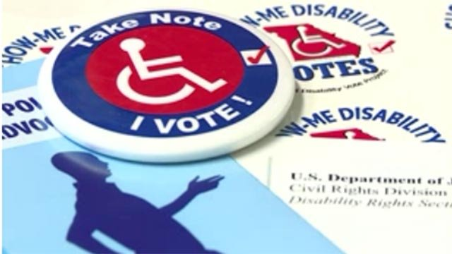 """Take Note I Vote!"" pin (Credit: KMOV)"