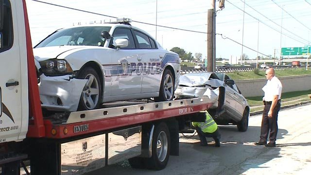 Police cruiser & suspect vehicle being towed (Credit: KMOV)