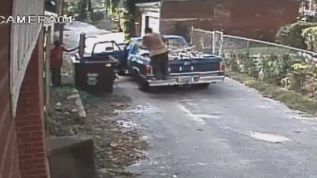 Suspects caught on camera illegally dumping in alley (Credit: Micah Hainline).