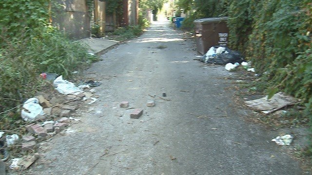 An alley between Maple and Vernon Avenues is littered with tires, wooden boards, bricks and concrete blocks (Credit: KMOV).
