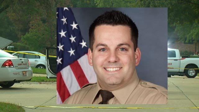 Louis County officer killed in shooting; suspect wounded
