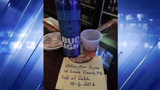 A photo of the beer, shot and note left on the bar at Hair of the Dog (Credit: Dana Kay Goddard)