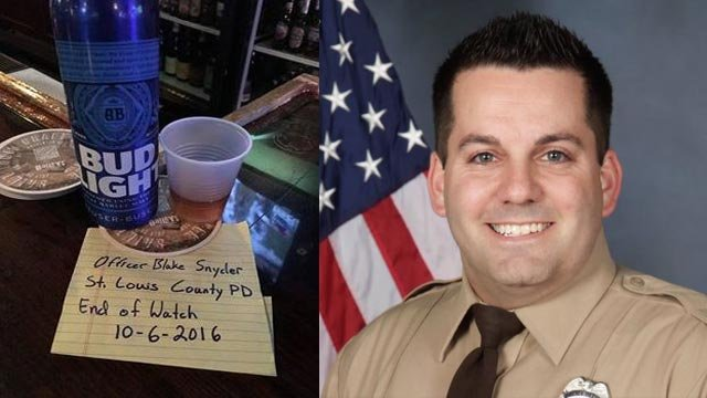 The beer, note and shot alongside a photo of Ofc. Snyder (Credit: Dana Kay Goddard & St. Louis County PD)