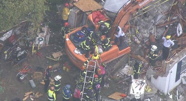 A construction worker was freed after being trapped (Credit: KMOV)