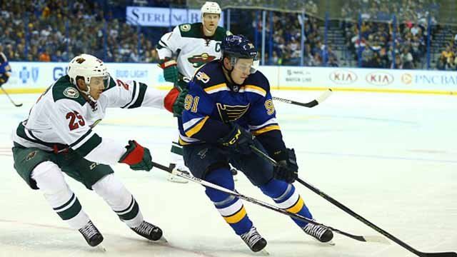 Vladimir Tarasenko #91 of the St. Louis Blues controls the puck against Jonas Brodin #25 of the Minnesota Wild in the third period at the Scottrade Center on October 13, 2016 in St. Louis, Missouri. (Photo by Dilip Vishwanat/Getty Images)