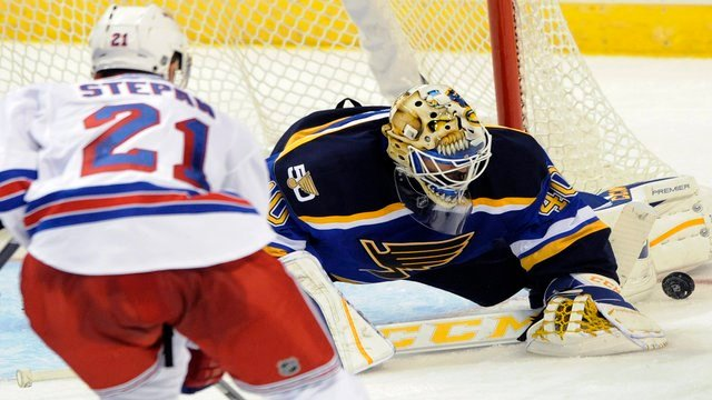 St. Louis Blues goalie Carter Hutton (40) blocks a shot by New York Rangers' Derek Stepan (21) during the third period of an NHL hockey game, Saturday, Oct. 15, 2016, in St. Louis. The Blues won 3-2. (AP Photo/Bill Boyce)