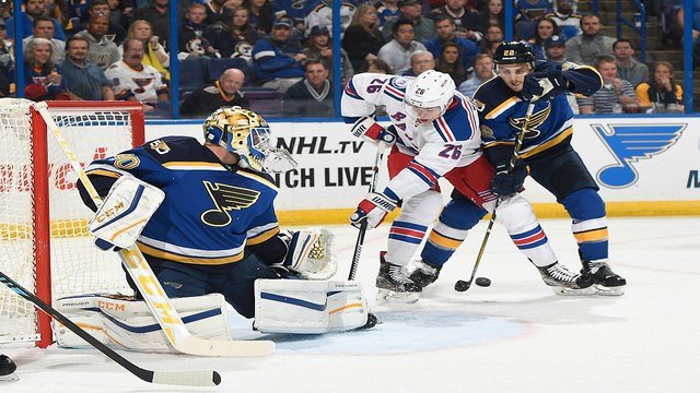 ST. LOUIS, MO - OCTOBER 15: Kevin Shattenkirk #22 of the St. Louis Blues defends against Jimmy Vesey #26 of the New York Rangers after Carter Hutton #40 of the St. Louis Blues makes a save on October 15, 2016 at Scottrade Center in St. Louis, Missouri.