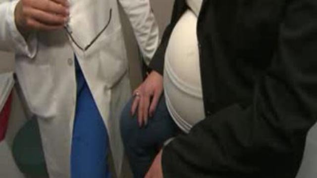 Pregnant woman next to a doctor (Credit: KMOV)