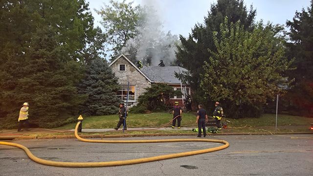 Firefighters battling fire at Eichelberger & Wherry Thursday morning (Credit: KMOV)