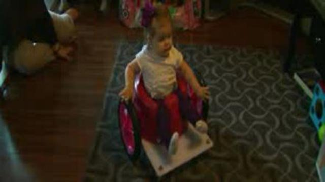 Faith Willis in her wheelchair created by high school students (Credit: KMOV)