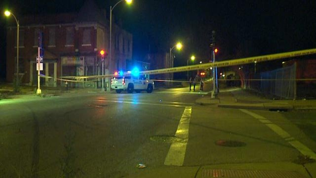 Police on the scene after a woman was shot Sunday (Credit: KMOV)