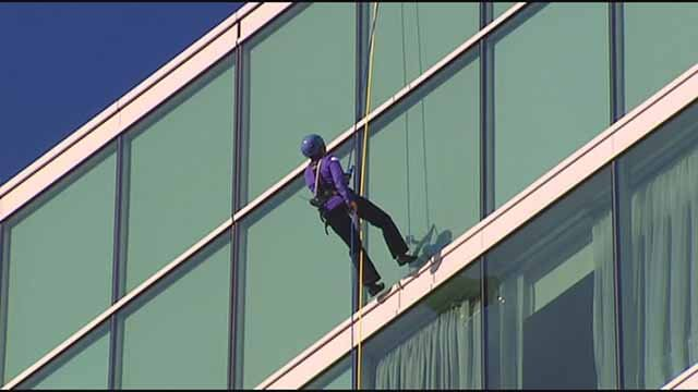 O'Fallon, Mo police officer Jill Bloomfield scaled the side of a local hotel to raise money for the Special Olympics on October 29. Credit: KMOV