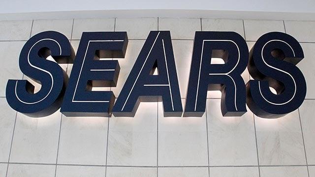 A Sears logo is displayed on a department store (Credit: AP Photo / Gene J. Puskar)