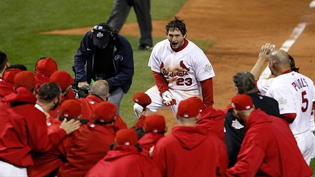 Teammates celebrate with St. Louis Cardinals' David Freese after Freese hit a walk-off home run during the 11th inning of Game 6 of baseball's World Series against the Texas Rangers Thursday, Oct. 27, 2011, in St. Louis.  (Credit: AP Photo / Eric Gay)
