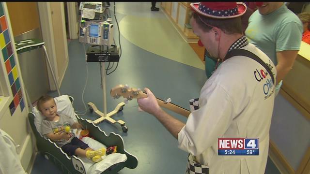 "A clown performer entertains a sick patient at Children's Hospital. Credit"" KMOV"