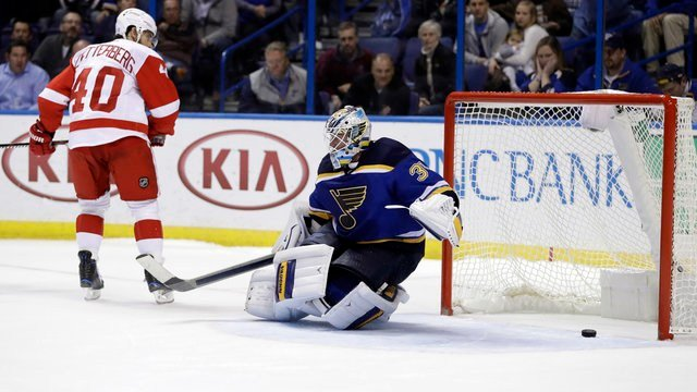 Detroit Red Wings' Henrik Zetterberg scores the game-winning goal past St. Louis Blues goalie Jake Allen, right, during a shootout of an NHL hockey game Thursday, Oct. 27, 2016, in St. Louis. The Red Wings won 2-1 in a shootout. (AP Photo/Jeff Roberson)