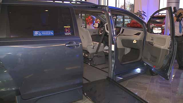 The community donated more than $50,000 to purchase a specialty van for Officer Mike Flamion. Credit: KMOV