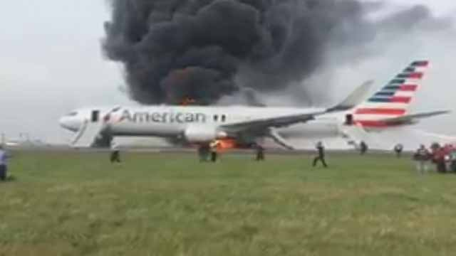 A plane caught on fire on the tarmac at O'Hare Airport in Chicago. Credit: Jose Castillo